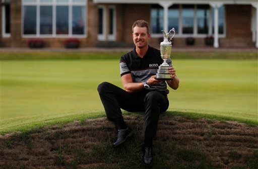 Henrik Stenson of Sweden poses with the trophy after winning the British Open Golf Championships at the Royal Troon Golf Club in Troon, Scotland, Sunday, July 17, 2016.