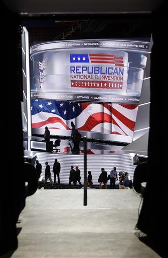 People gather around the stage as preparations take place at Quicken Loans Arena for the Republican National Convention, Sunday, July 17, 2016, in Cleveland.