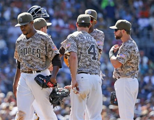 San Diego Padres starting pitcher Edwin Jackson leaves the pitcher's mound after being relieved by manager Andy Green after allowing his first hit of a baseball game against the San Francisco Giants in the seventh inning.