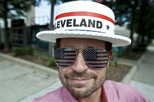 Andy Sandy wears an RNC hat and pair of American flag glasses while walking around, Sunday, July 17, 2016, in Cleveland. The Republican National Convention starts Monday.