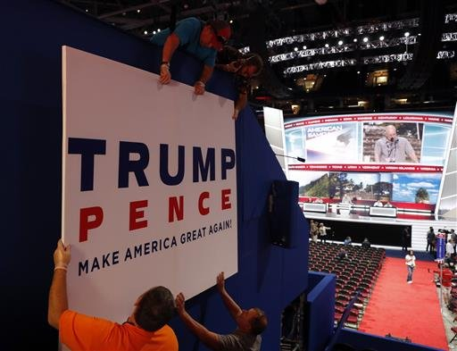 Workers place a sign as they prepare at Quicken Loans Arena for the Republican National Convention, Sunday, July 17, 2016, in Cleveland.