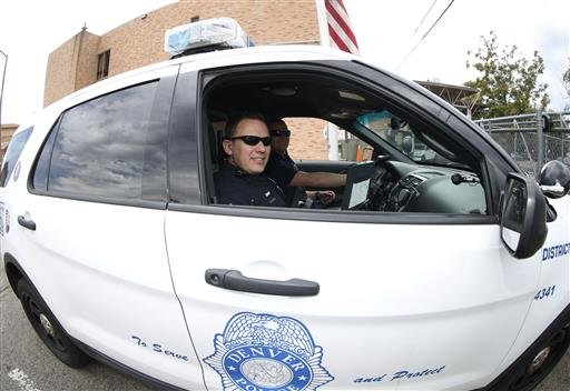 Denver Police Department officers head out in their patrol car after role call for the swing shift in District 6 in downtown Denver.