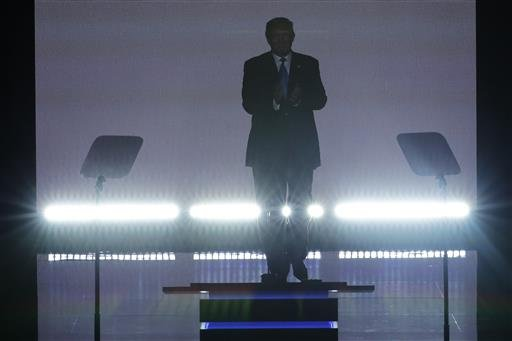 Republican Presidential Candidate Donald Trump applauds as he steps to the podium to introduce his wife Melania during the opening day of the Republican National Convention in Cleveland, Monday, July 18, 2016.