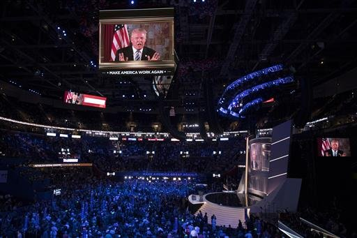 Republican presidential candidate Donald Trump appears on a video monitor during the Republican National Convention, Tuesday, July 19, 2016, in Cleveland.
