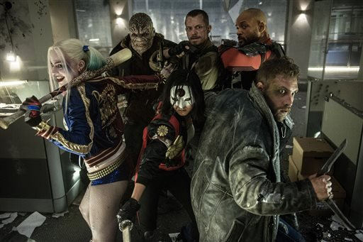 "In this image released by Warner Bros. Entertainment, cast members, clockwise from left, Margot Robbie, Adewale Akinnuoye-Agbaje, Joel Kinnaman, Will Smith, Jai Courtney and Karen Fukuhara appear in the film, ""Suicide Squad."""