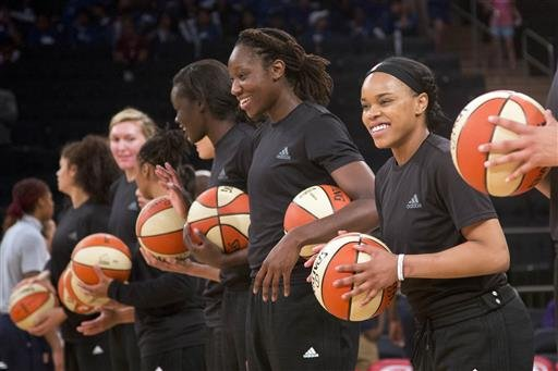 In this Wednesday, July 13, 2016 file photo, members of the New York Liberty basketball team await the start of a game against the Atlanta Dream, in New York.