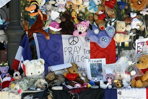 Dolls and teddy bears are placed at a memorial in a gazebo on the Promenade des Anglais in Nice, southern France, Wednesday, July 20, 2016.
