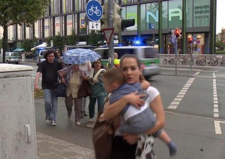 A manhunt was underway Friday for a shooter or shooters who opened fire at a shopping mall in Munich, killing and wounding several people, a Munich police spokeswoman said. The city transit system shut down and police asked people to avoid public places.