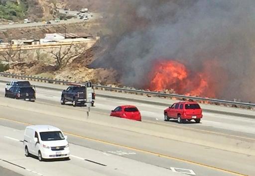 California wildfires: Hundreds flee homes near Los Angeles