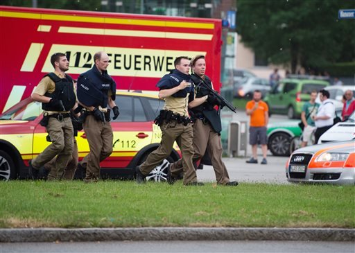Policemen arrive at a shopping centre in which a shooting was reported in Munich, southern Germany, Friday, July 22, 2016.