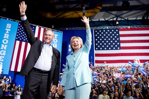 Democratic presidential candidate Hillary Clinton and Sen. Tim Kaine, D-Va., arrive at a rally at Florida International University Panther Arena in Miami, Saturday, July 23, 2016.