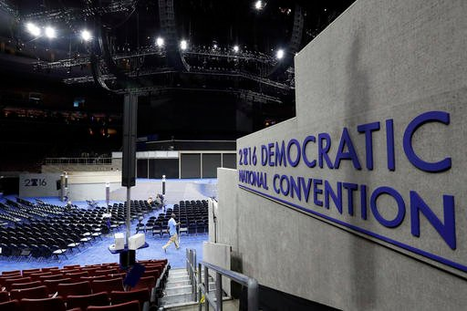 Work continues inside the convention hall before the Democratic National Convention, Saturday, July 23, 2016, in Philadelphia.