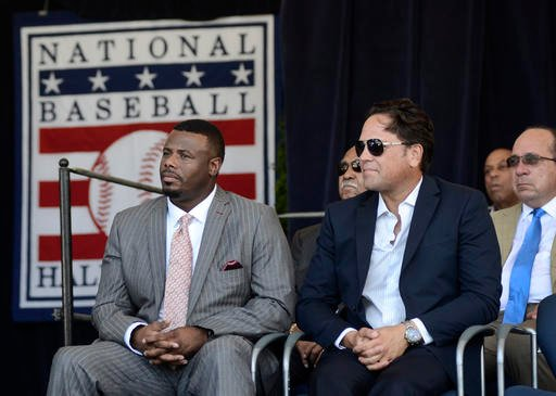 Ken Griffey Jr., left, and Mike Piazza listen during an awards ceremony at Doubleday Field on Saturday, July 23, 2016, in Cooperstown, N.Y.