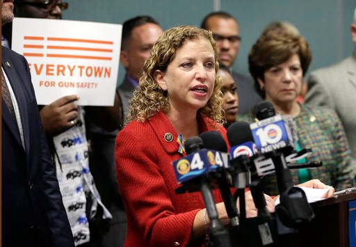 In a Tuesday, July 5, 2016 file photo, Congresswoman Debbie Wasserman Schultz, D-Fla., speaks during a news conference, in Fort Lauderdale, Fla. On Sunday, July 24, 2016, Wasserman Schultz announced she would step down as DNC chairwoman at the end of the