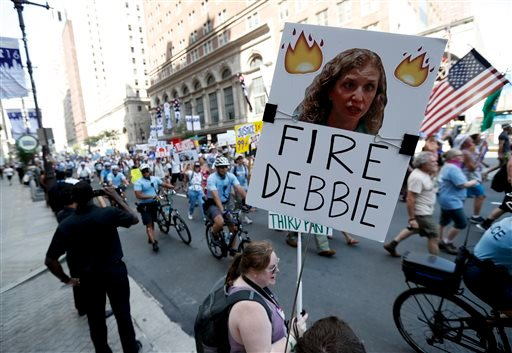 A supporters of Sen. Bernie Sanders, I-Vt., holds up a sign call calling for Debbie Wasserman Schultz, chairwoman of the Democratic National Committee to be fired, Sunday, July 24, 2016, in Philadelphia. The Democratic National Convention starts Monday. (