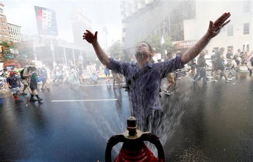 A supporter of Sen. Bernie Sanders, I-Vt., cools off during a march in downtown on Sunday, July 24, 2016, in Philadelphia. The Democratic National Convention starts Monday in Philadelphia.(AP Photo/Alex Brandon)