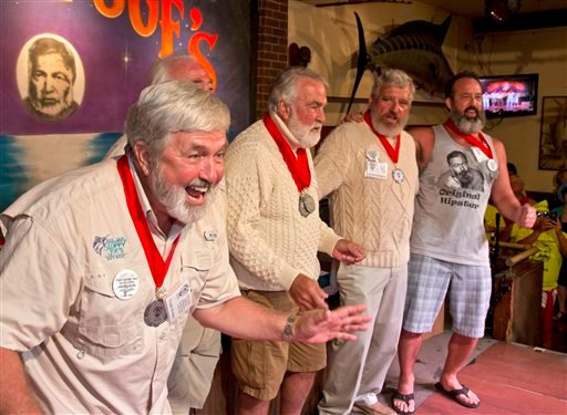 """In this Saturday, July 23, 2016 photo provided by the Florida Keys News Bureau, Frank Kramer, left, implores the judges to choose him to be the winner of the 2016 Ernest """"Papa"""" Hemingway Look-Alike Contest at Sloppy Joe's Bar in Key West, Fla. Kramer didn"""