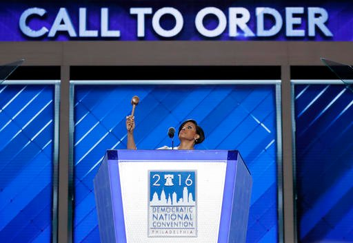 Baltimore Mayor Stephanie Rawlings-Blake raises the gavel as she calls the convention to order during the first day of the Democratic National Convention in Philadelphia , Monday, July 25, 2016.