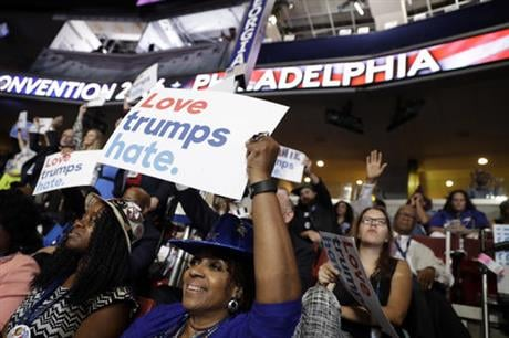 Georgia delegate Pat Pullar holds up a sign during the first day of the Democratic National Convention in Philadelphia , Monday, July 25, 2016. (AP Photo/Matt Rourke)