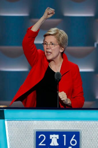 Sen. Elizabeth Warren, D-Mass., pumps her fist in the air after her speech during the first day of the Democratic National Convention in Philadelphia , Monday, July 25, 2016. (AP Photo/J. Scott Applewhite)