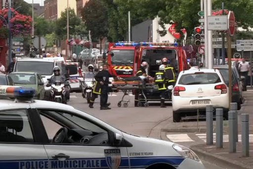 In this grab made from video, emergency services transport a person into a waiting ambulance in Normandy, France, Tuesday, July 26, 2016. Two attackers seized hostages in a church near the Normandy city of Rouen on Tuesday, killing one hostage by slitting