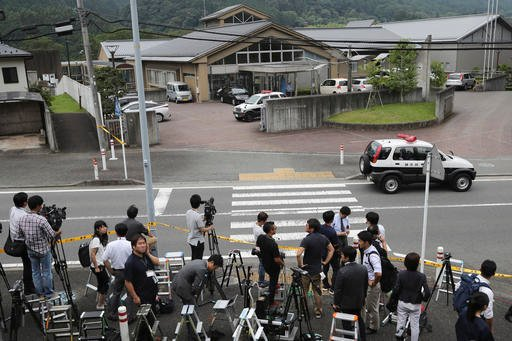 Journalists gather in front of Tsukui Yamayuri-en, a facility for the handicapped where a number of people were killed and dozens injured in a knife attack in Sagamihara, outside Tokyo Tuesday, July 26, 2016. Police said they responded to a call about 2:3