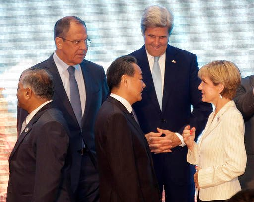 Russia's Foreign Minister Sergey Lavrov, U.S. Secretary of State John Kerry, rear, stand with India's Minister of External Foreign Affairs General V.K. Singh, left, China's Foreign Minister Wang Yi, center, and Australia's Foreign Minister Julie Bishop as