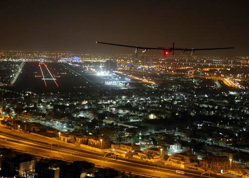 The Solar Impulse 2 plane approaches to land at Al Bateen Executive Airport in Abu Dhabi, United Arab Emirates, on Tuesday, July 26, 2016. The world's first ever round-the-world flight to be powered solely by the sun's energy made history with its landing