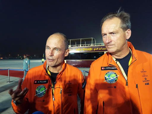 Solar Impulse 2 pilots Bertrand Piccard, left, and Andre Borschberg speaks with the media as they celebrate the landing of their plane at an airport in Abu Dhabi, United Arab Emirates, early Tuesday, July 26, 2016. The world's first round-the-world flight