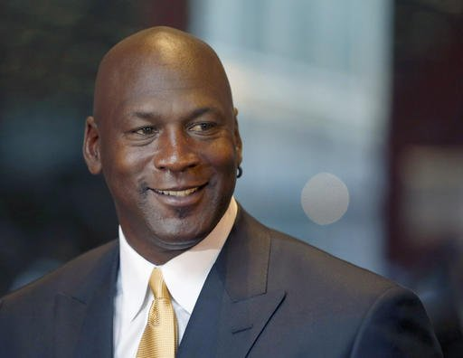 In this Aug. 21, 2015, file photo, former NBA star and current owner of the Charlotte Hornets, Michael Jordan, smiles at reporters in Chicago.