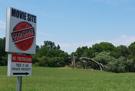 """This Friday, July 22, 2016, photo provided by Jodie Snavely shows a fallen oak tree made popular by its role in the movie """"The Shawshank Redemption,"""" in Ohio."""