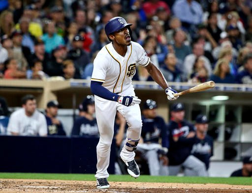 In this June 7, 2016, file photo, San Diego Padres' Melvin Upton Jr. watches his RBI line-out against the Atlanta Braves during the fifth inning of a baseball game, in San Diego.