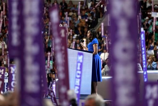 First lady Michelle Obama speaks to delegates during the first day of the Democratic National Convention in Philadelphia, Monday, July 25, 2016. (AP Photo/John Locher)