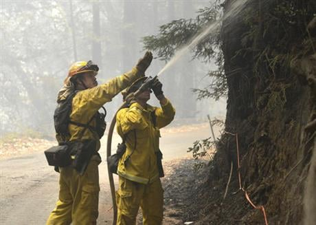 California's signature parks along the Big Sur coastline that draw thousands of daily visitors were closed Tuesday as one of the state's two major wildfires threatened the scenic region at the height of the summer tourism season. (David Royal/The Monterey