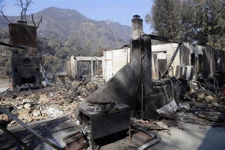 The fire destroyed 18 homes and authorities said that by Tuesday it had burned more than 37,000 acres, about 58 square miles. (AP Photo/Nick Ut)