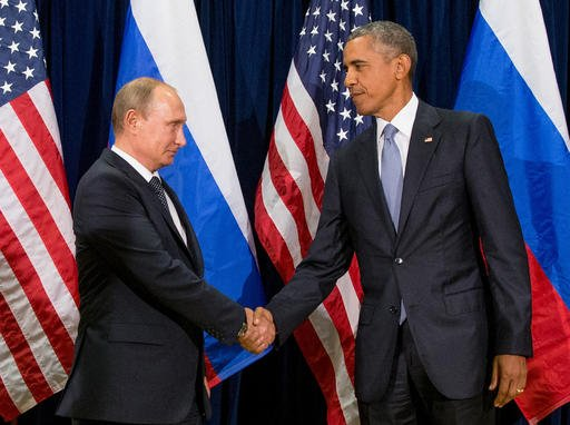 In this Sept. 28, 2015 file photo, President Barack Obama shakes hands with Russian President President Vladimir Putin.