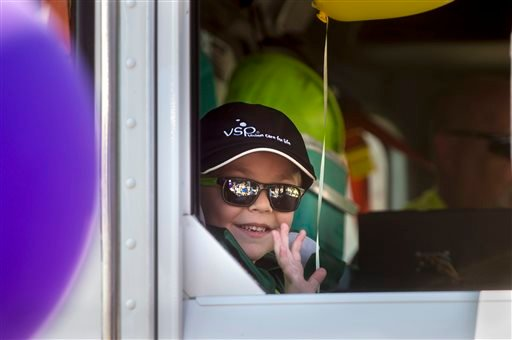 Six-year-old Ethan Dean, who was diagnosed with cystic fibrosis at two weeks old, rides in a waste truck as his wish to be a garbage man came true for a day in Sacramento, Calif., on Tuesday, July 26, 2016. Thanks to the Make-A-Wish Foundation, he got to