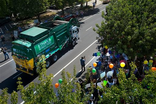 Six-year-old Ethan Dean, who was diagnosed with cystic fibrosis at two weeks old, has his wish to be a garbage man come true for a day in Sacramento, Calif., Tuesday, July 26, 2016. Thanks to the Make-A-Wish Foundation, he got to experience what it's like