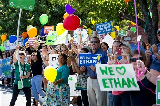 Fans and supporters wave as, 6-year-old Ethan Dean, who was diagnosed with cystic fibrosis at two weeks old, arrives in front of the Sacramento Bee in Sacramento, Calif., on Tuesday, July 26, 2016. Thanks to the Make-A-Wish Foundation, he got to experienc