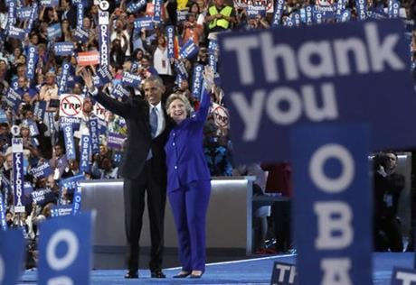 President Barack Obama and Democratic Presidential candidate Hillary Clinton wave together on the third day of the Democratic National Convention in Philadelphia , Wednesday, July 27, 2016. (AP Photo/Paul Sancya)