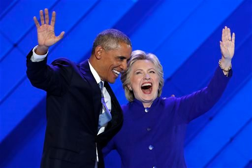 President Barack Obama and Democratic Presidential nominee Hillary Clinton wave to delegates after President Obama's speech.