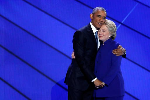 Democratic Presidential nominee Hillary Clinton hugs President Barack Obama after joining him on stage during the third day of the Democratic National Convention.