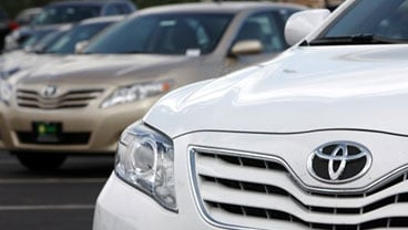 In this Aug. 16 2009, the Toyota logo shines off the nose of a 2010 Camry sedan at a Toyota dealership in Centennial, Colo. The Commerce Department said Thursday, Sept. 10, 2009, U.S. trade deficit shot up in July to the highest level in six months as a s