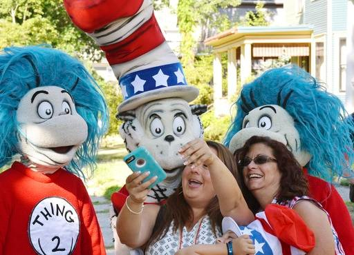 A character portraying the Cat in the Hat parades with Thing 2, Tuesday, July 26, 2016, after he declared he is running for President with running mates Thing 1 and Thing 2, outside the childhood home of their creator Theodor Geisel, better known as Dr. S