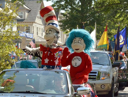 A character portraying the Cat in the Hat announces Tuesday, July 26, 2016, he is running for President with running mates Thing 1 and Thing 2 outside the childhood home of their creator Theodor Geisel, better known as Dr. Seuss, on Fairfield Street in Sp