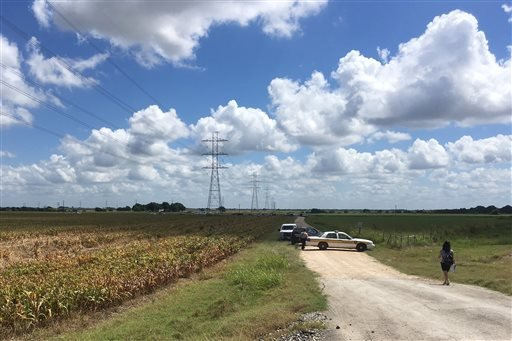 Police cars block access to the site where a hot air balloon crashed early Saturday, July 30, 2016, near Lockhart, Texas.