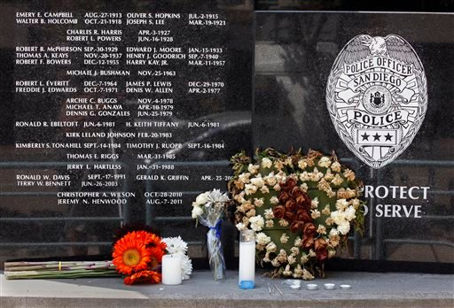Flowers and candles were left at the San Diego Police Department memorial to officers who died in the line of duty.