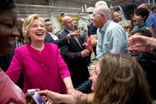 Democratic presidential candidate Hillary Clinton greets members of the audience after speaking at a rally at K'NEX, a toy company in Hatfield, Pa., Friday, July 29, 2016. Clinton and Democratic Vice Presidential candidate, Sen. Tim Kaine, D-Va. begin a t