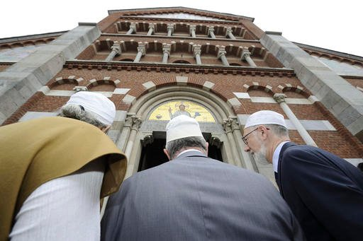 Members of the Italian Muslim communities arrive to attend a Mass in Milan's Santa Maria in Caravaggio church, Italy, Sunday, July 31, 2016. Imams and practicing Muslims attended Mass across Italy, from Palermo in the south to Milan in the north, in a sig