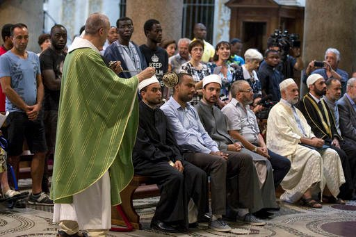 Muslims attend a Mass in Rome's Saint Mary in Trastevere church, Italy, Sunday, July 31, 2016. Imams and practicing Muslims attended Mass across Italy, from Palermo in the south to Milan in the north, in a sign of solidarity after the France church attack